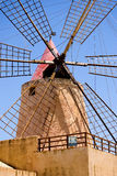 Wind Mill against blue sky. This old wind mill near Trapani in Sicilia, Italy was used to pump seawater. This was stored in ponds and let to dry. When all the Stock Images