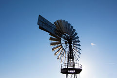 The Wind mill against  blue sky Stock Images