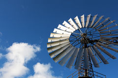 Wind mill against a blue sky Royalty Free Stock Photo