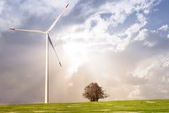 Wind mill against sunny sky Stock Photos