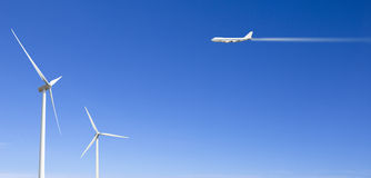 Wind mill and airplane Royalty Free Stock Photography