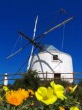 Wind mill in Algarve, Portugal. White wind mill in Algarve, Portugal royalty free stock images