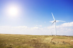 Wind mill  in autumn farm land Royalty Free Stock Image