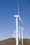Wind mill clean power. Wind turbines renewable power over a blue sky Royalty Free Stock Photo