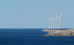 Wind mill farm. By the Ocean royalty free stock photography