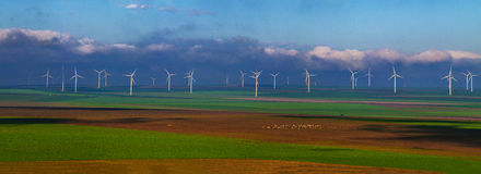 Wind mill filled field Royalty Free Stock Photos