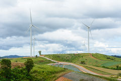 Wind mill in landsape against sky with clouds for energy power p Stock Photo