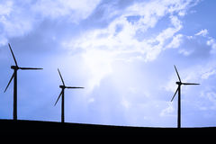 Wind mill park on meadow silhouettes Royalty Free Stock Photography