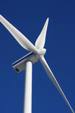 Wind mill power generator. In action Royalty Free Stock Images