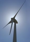 Wind mill power generator. Backlit vertical perspective Stock Photo