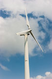 Wind mill power plan tagainst blue sky Stock Photo