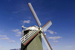 Wind mill replica. A wind mill replica of Holland with blue sky and white clouds Royalty Free Stock Image