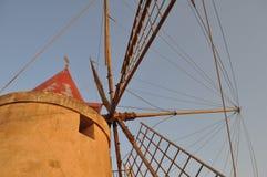Windmill at saline (Salt flats) in Marsala Royalty Free Stock Photo