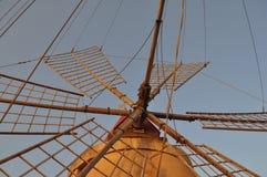 Windmill at saline (Salt flats) in Marsala Royalty Free Stock Photos