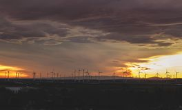 Wind Mill during Sunset Stock Images