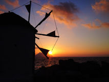 Wind mill on sunset Stock Photo