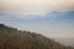 Wind mill field on the top of mountain. The wind mill on the top of the mountain in Thailand with pink sky background Royalty Free Stock Photos