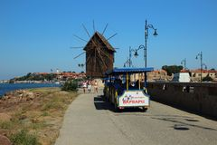Wind mill and a tourist train Royalty Free Stock Photo