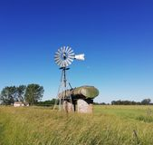 Wind mill with truck tank country royalty free stock photo
