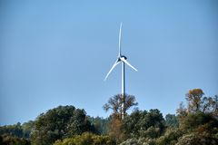 Wind mill turbine with blue sky landscape Stock Photo