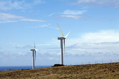 Wind mill turbines against blue sky with clouds Royalty Free Stock Photo