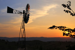 Wind mill, wind turbine, silhouette in the sunset sky, Stock Photo