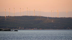 Wind mill, windmill farm producing electricity great sunset stock video