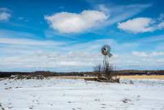 Wind mill. Winter wind mill snow on the ground clouds in the sky Stock Photos