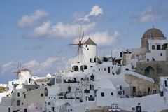 Wind mills and architecture at Santorini Stock Photo