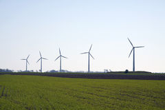 Wind mills on a green field Stock Photography