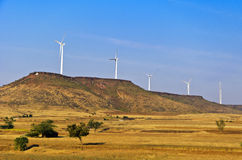 Wind Mills on the Hills. Wind mills atop a hill, in arid land of the state of Karnataka, India Stock Image