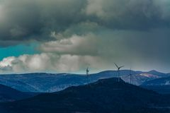 Wind mills in the mountains stock photos