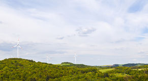 Wind mills producing energy Stock Photos