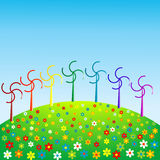 Wind mills in rainbow colors, eco concept Stock Images