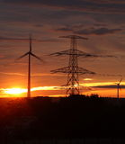 Wind mills at sunrise Stock Photos