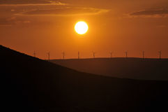 WIND MILLS AT SUNSET Royalty Free Stock Photo