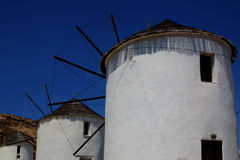 Wind mills. Three white wind mills in Cyclades, Greece Royalty Free Stock Photo