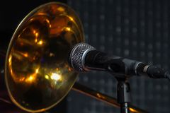 Trombone in front of a microphone. Wind musical instruments. Trombone in front of a microphone Stock Photos