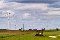 Wind and oil power Royalty Free Stock Image