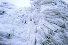 Wind painted Snow Texture Pattern on stone Background, Winter. Royalty Free Stock Image
