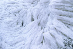 Wind painted Snow Texture Pattern on stone Background, Winter. Royalty Free Stock Photo
