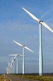 Wind park. Several windmills at a dyke Stock Photography