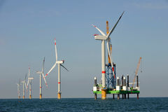 Wind park northern sea, offshore and wind turbines Stock Image