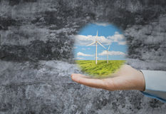 Wind power in one hand Stock Photography