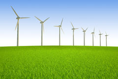 Wind power. Turbines system on green meadow hill Royalty Free Stock Photography