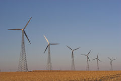 Wind Power. Alternative Energy - A row of large wind powered generators Stock Image