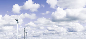 Wind power. Wind turbines in front of the sky stock photo
