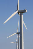 Wind Power. Close-up of three wind turbines against a blue sky Stock Images