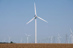 Wind Power. Turbines spin on a wind farm Stock Photos