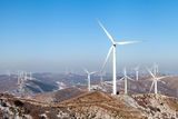 Wind Power. Larger windmills to generate electricity Stock Photos